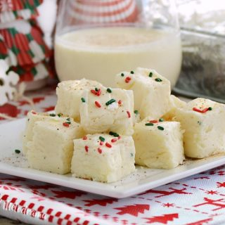 fantasy eggnog fudge on plate with eggnog