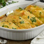 honey mustard curry chicken dinner in white serving dish