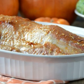 maple mustard pork roast in white baking dish