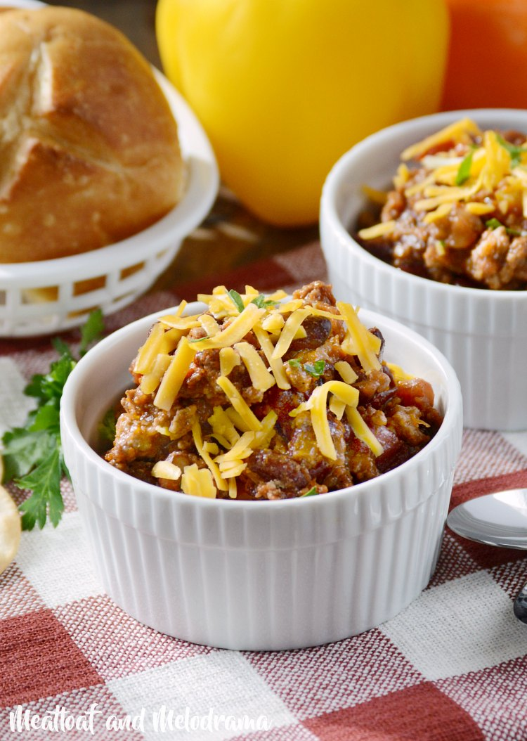mom's best chili recipe with shredded cheese in bowl