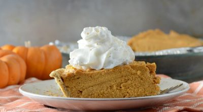 no-bake pumpkin cheesecake pie on plate with whipped cream