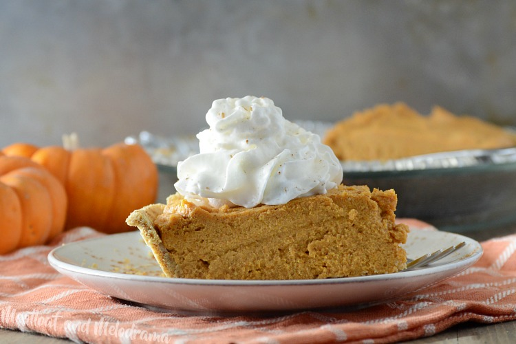 no bake pumpkin cheesecake pie on plate with whipped cream