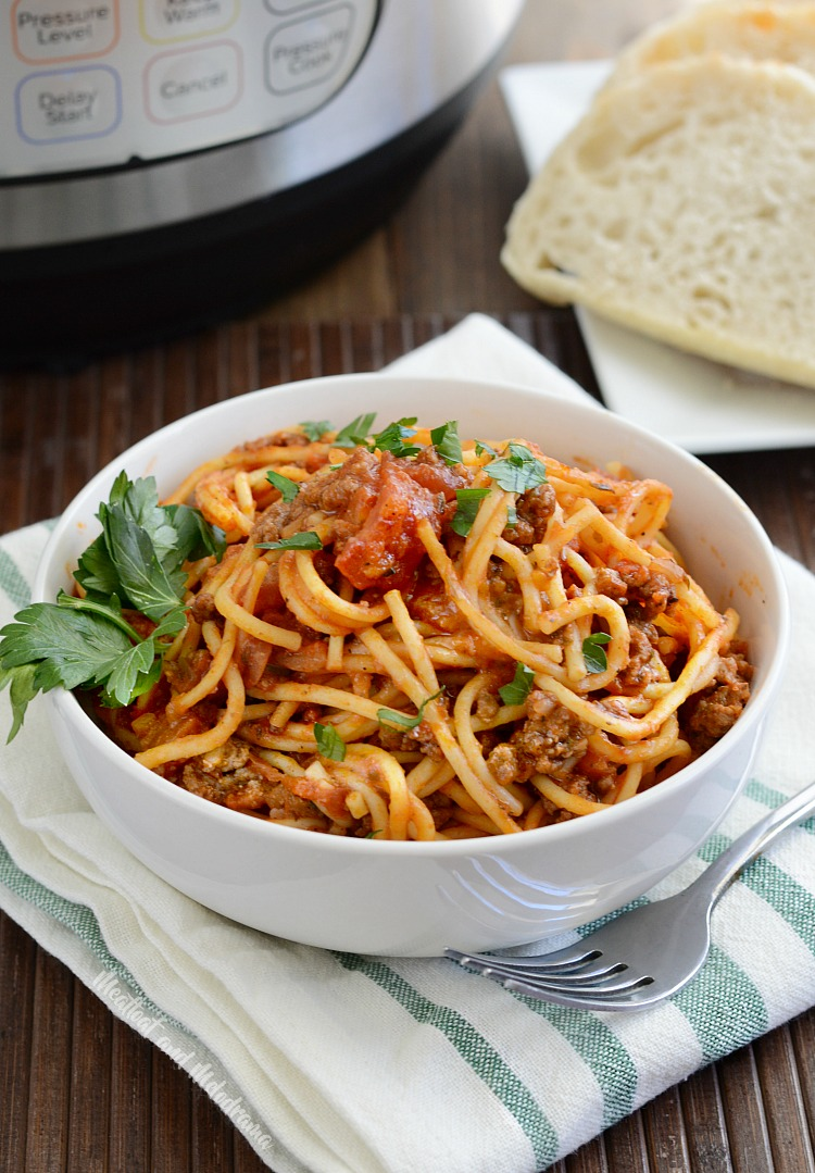 instant pot spaghetti and meat sauce in bowl with side of bread