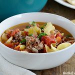 ground beef noodle soup in white bowl