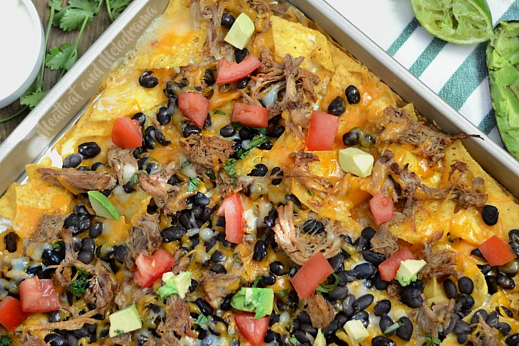 sheet pan pulled pork nachos on baking sheet