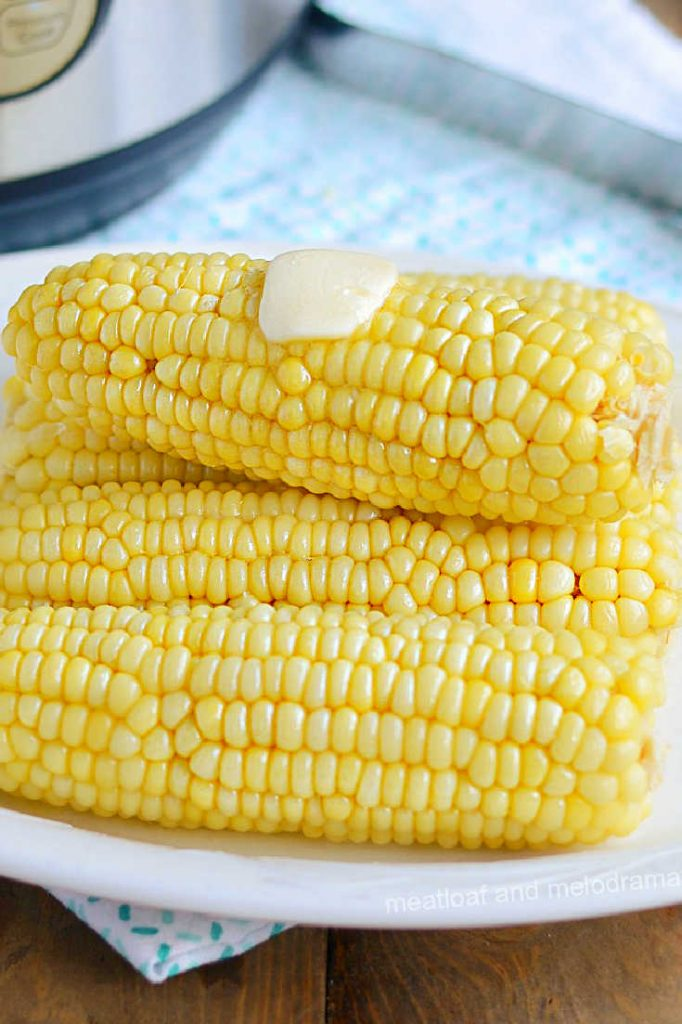 plate of corn on the cob with butter on top