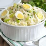 instant pot potato salad in a bowl with hard cooked eggs and celery