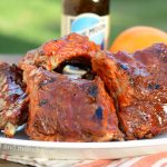 instant pot beer ribs with orange valencia beer on a platter