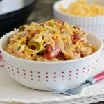 instant pot macaroni beef casserole with cheese in white bowl