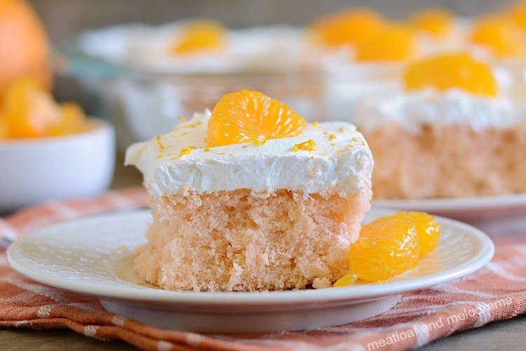 orange crush soda pop cake with cool whip frosting and mandarin orange slices