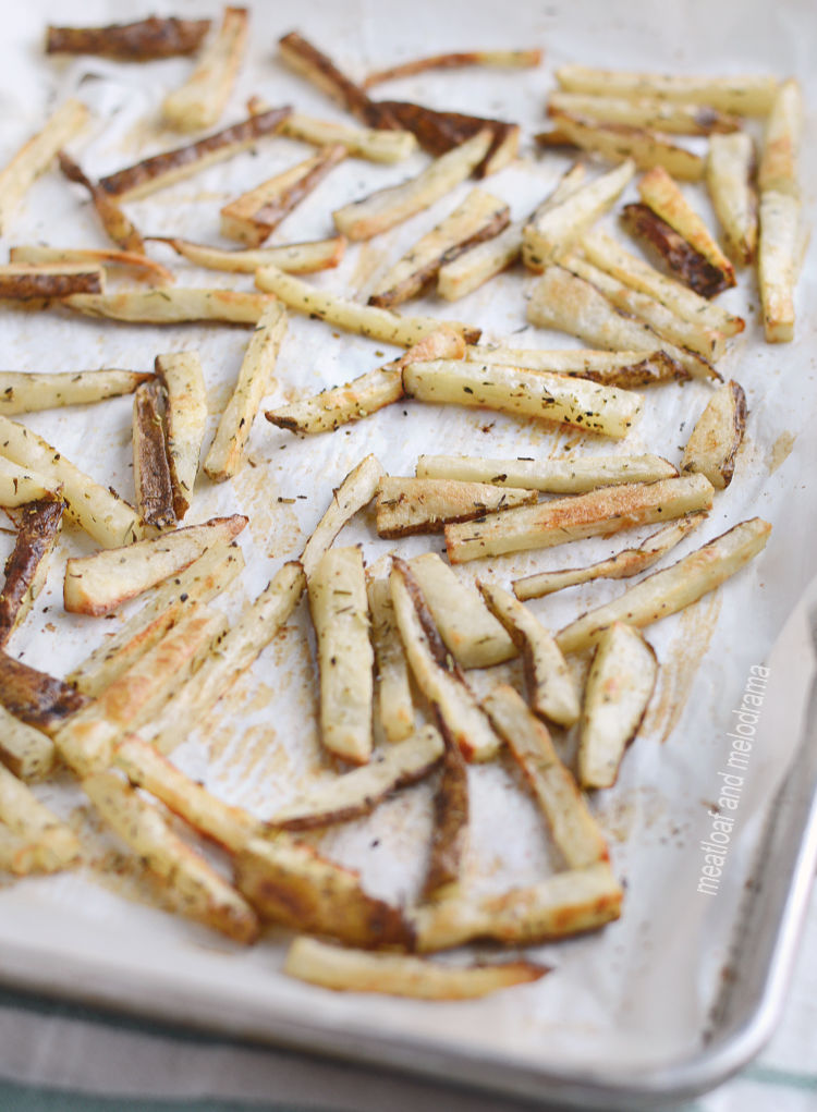 homemade baked french fries on parchment baking sheet