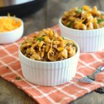 instant pot bbq macaroni and beef with cheddar cheese in white bowls