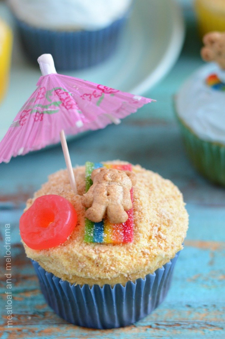 summer beach party cupcakes with teddy bear on candy blanket and umbrella
