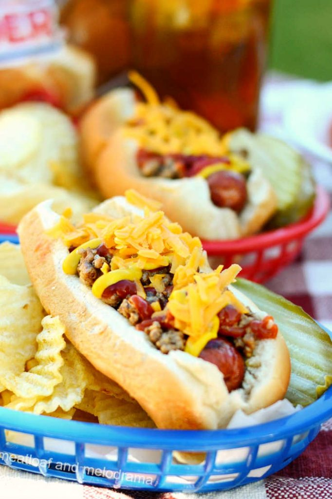 hot dog with meat and cheese on top