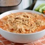 instant pot buffalo chicken recipe shredded in white bowl
