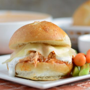 instant pot buffalo chicken sliders with ranch and provolone cheese on plate