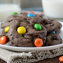 chocolate cake mix cookies with peanut butter candies on white plate