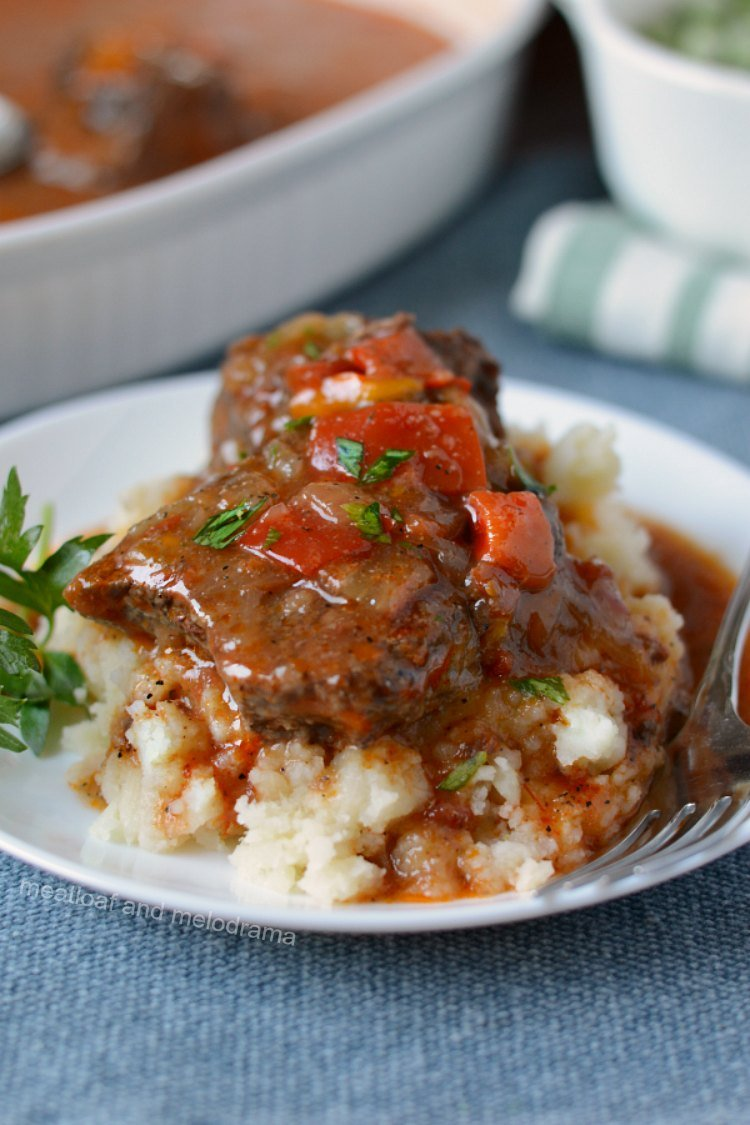instant pot swiss steak with tomato beef sauce on plate