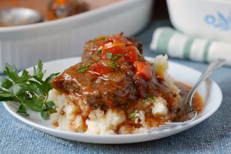 instant pot swiss steak over mashed potatoes on white plate