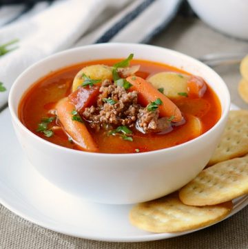 instant pot hamburger soup in white bowl with crackers