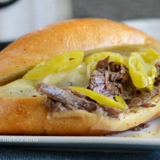 instant pot italian beef sandwiches on roll with provolone cheese and pepperoncini
