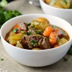 easiest instant pot beef stewith potatoes and carrots n white bowl