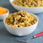 instant pot cheeseburger macaroni in white bowls