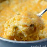 instant pot corn casserole with cheese on a spoon