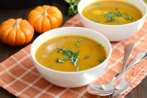 instant pot easy pumpkin soup in white bowls with parsley