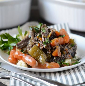 instant pot pot roast with carrots and mashed potatoes on plate