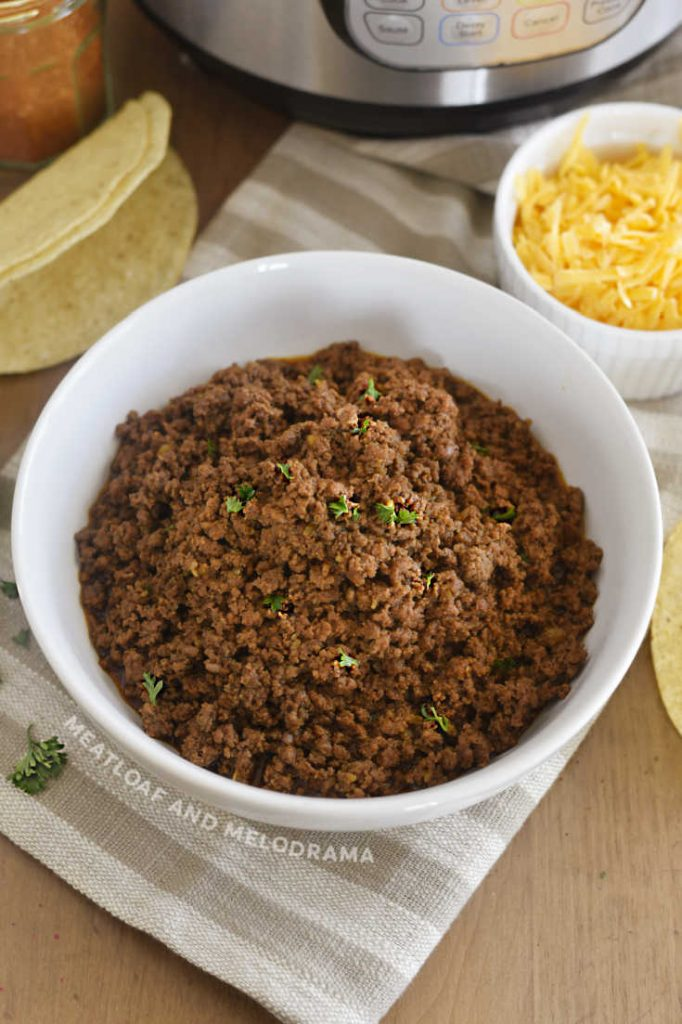 bowl of ground beef for tacos with cilantro and cheese