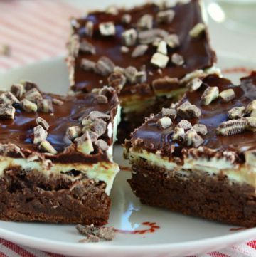 mint chocolate chip brownies topped with andes mints on a candy cane plate