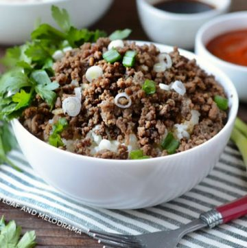 instant pot korean ground beef topped with scallions over rice in white bowl