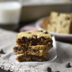 easy oatmeal chocolate chip cookie bars stacked with milk