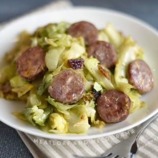 pan fried kielbasa and cabbage on a white plate