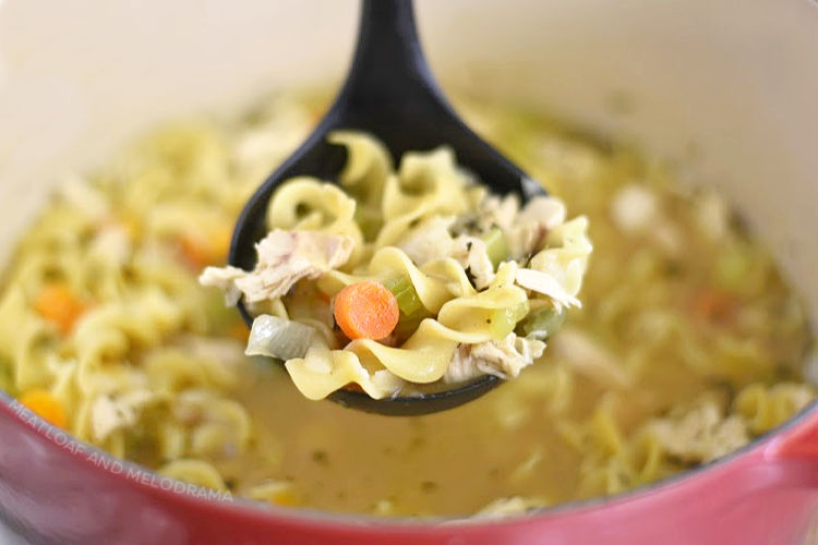homemade chicken noodle soup in ladle