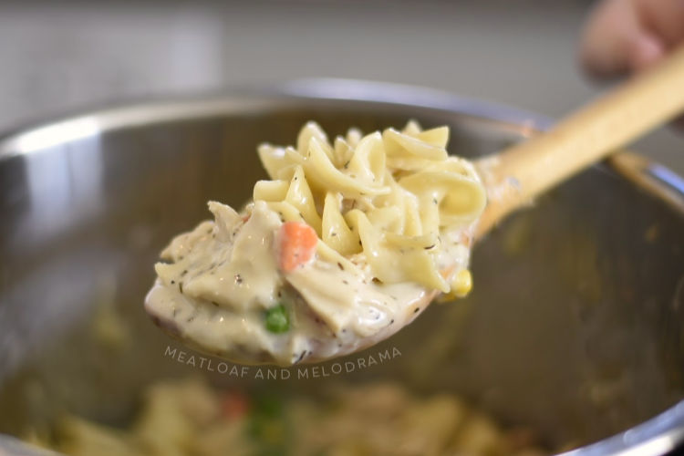 instant pot chicken noodle casserole on wooden spoon