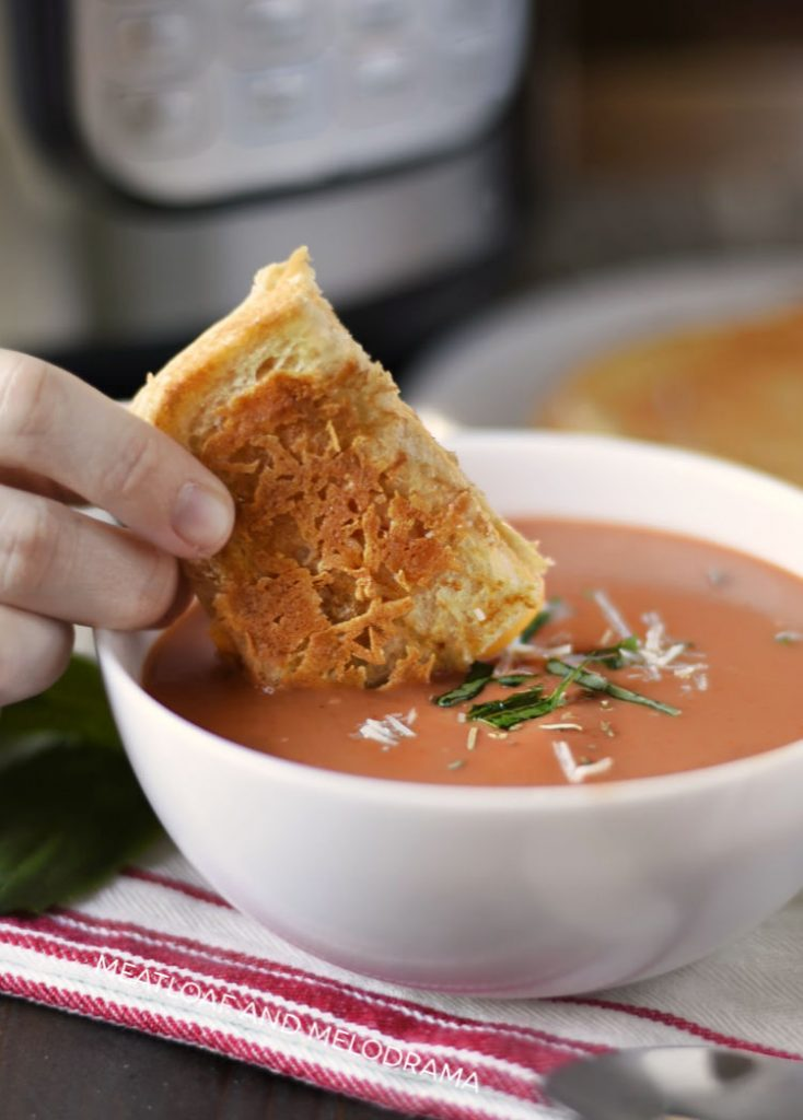 dunk grilled cheese in tomato basil soup
