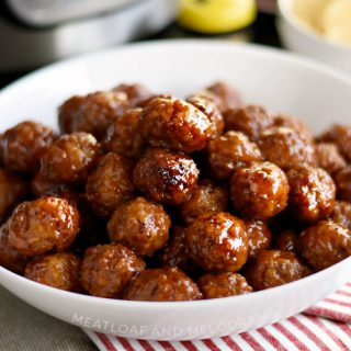 instant pot grape jelly meatballs with sweet chili sauce in serving bowl