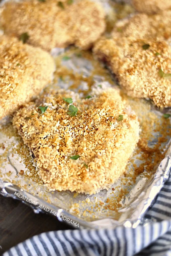 crunchy oven baked breaded pork chops with panko bread crumbs cooked on baking sheet