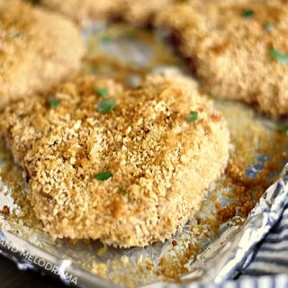 crispy baked breaded pork chops with panko on baking sheet
