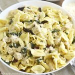 creamy chicken tortellini in white bowl