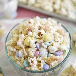 bunny bait snack mix with popcorn chex mix mini marshmallows and easter candy in a glass bowl