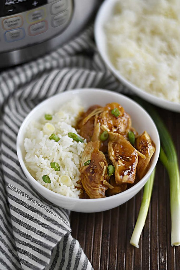 instant pot teriyaki chicken in white bowl with jasmine rice and scallions