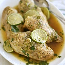 instant pot honey lime chicken breasts on white platter with lime slices