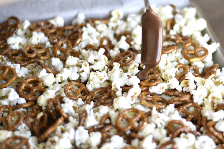 drizzle chocolate over popcorn and pretzels
