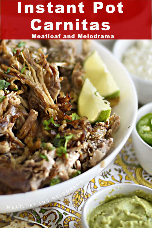 Instant Pot carnitas in a white serving bowl with taco toppings