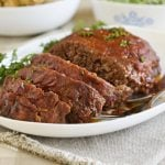 favorite meatloaf topped with savory tomato sauce glaze on a white platter