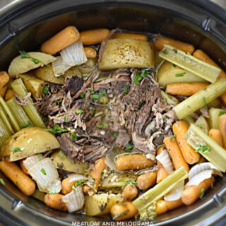 shredded fall apart chuck roast with potatoes, carrots and celery in the crock-pot