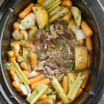 fall apart shredded chuck roast in the crock pot with potatoes, carrots and celery